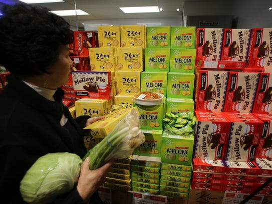 A woman shops for Korean sweets at H Mart, an Asian-focused