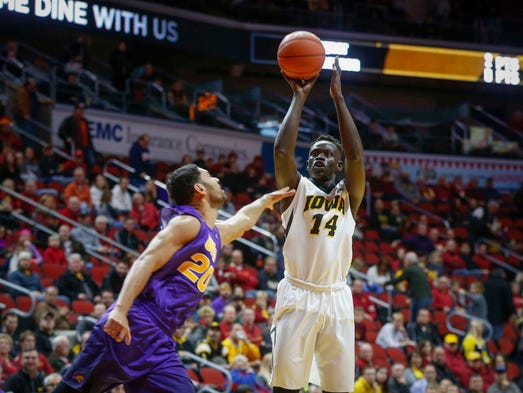 Iowa senior Peter Jok fires a three-pointer against