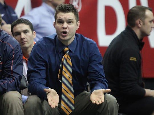 Illinois associate coach and former Hawkeye wrestler