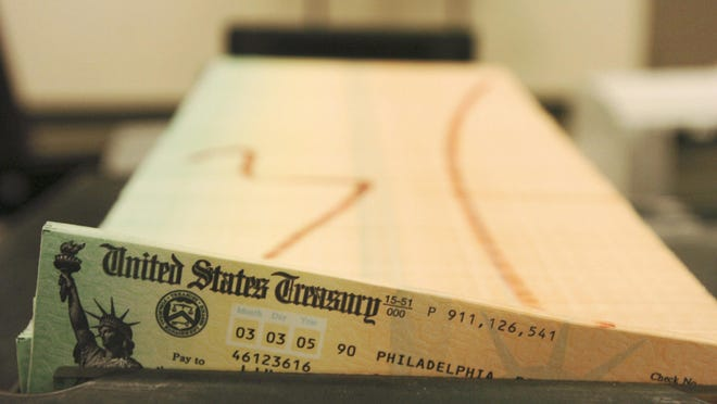 FILE - In this Feb. 11, 2005 file photo, trays of printed social security checks wait to be mailed from the U.S. Treasury's Financial Management services facility in Philadelphia.