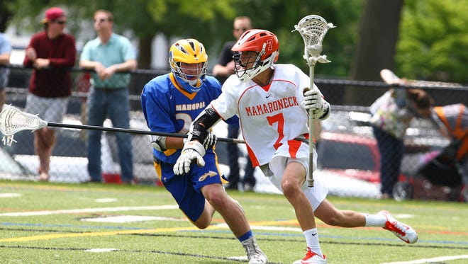 Mamaroneck's attack man Reed Malas (7) works the ball behind the Mahopac net as Mamaroneck plays Mahopac in the boys lacrosse Class A Quarterfinal at Mamaroneck High School on May 18, 2013.   Mamaroneck took the win, 10-0.  ( John Meore/The Journal News )