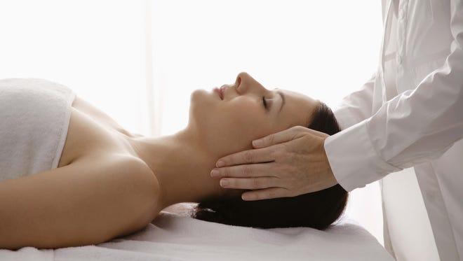 Woman having a reiki massage therapy treatment.