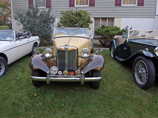 A view of 1970s MG B, a 1949 MG TD, and a 1949 MG TC