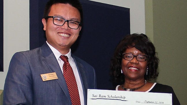 Fourth-year student Kai Chen (left) and Fort Pierce regional campus dean, Dr. Juliette Lomax-Homier
