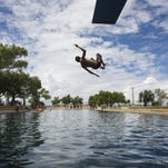A boy jumps off the diving board into 30 feet of water at the natural spring pool at the Balmoreah State Park in Balmoreah, Texas. The rise of fracking nearby has some community members worried about their drinking water and natural springs in this tourism destination.