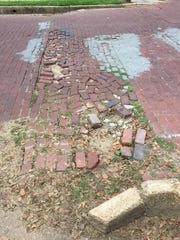 A spot on the brick roadway on Albert Street in need