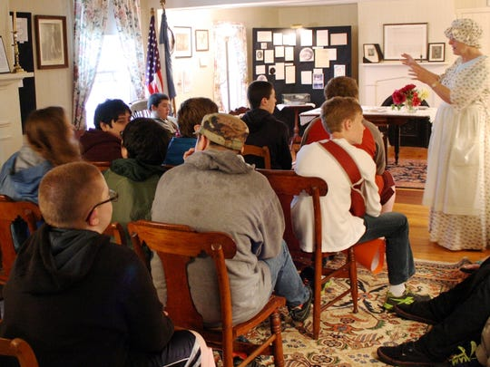 Daughters of the American Revolution member Joann Schmidt teaches seventh-graders about Major Gen. Richard Montgomery.