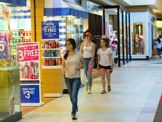 Shoppers browse at Mesilla Valley Mall on Tuesday,