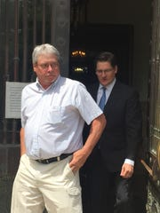 Jeffrey Horton, left, leaves the Tompkins County Courthouse on June 1 during an afternoon intermission in jury selection for his case. Horton is accompanied by his lawyer, Kenneth Moynihan.