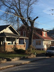 Police found five guns, about 200 rounds of ammunition and $107,000 in cash in this duplex, left, after a police chase resulted in gunfire that stuck a neighboring home.