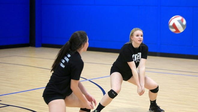 Caroline Marsh, right, is one of the top players for the Xcel Volleyball Performance program.
