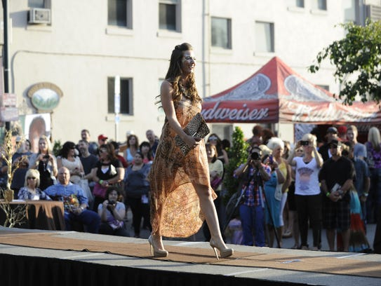 A model walks the runway at the Downtown Expo in 2012.