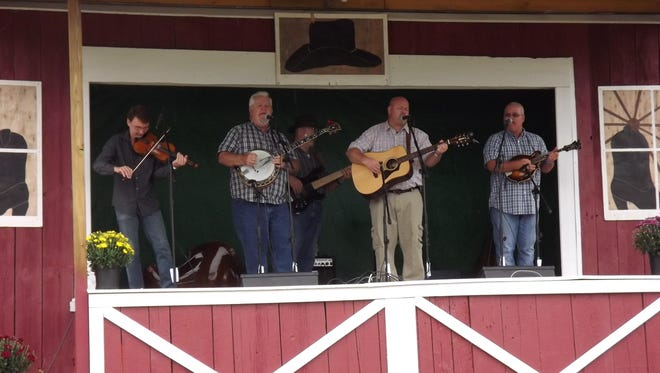 Matthews Family Tradition performs at last year's bluegrass festival at the North Barton Grange.