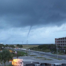 A water spout forms over Pensacola Beach Monday night.