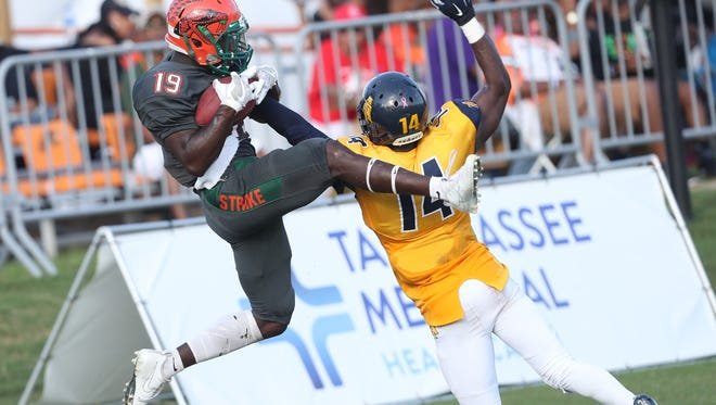 FAMU's Kareem Smith catches a touchdown against N.C. A&T's Timadre Abram at Bragg Memorial Stadium Saturday, Oct. 14, 2017.
