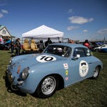 A Porsche 1600 Super sits on display during the Water by the Bridge Car Show at Waterfront Park in Louisville, Ky. March 28, 2015.