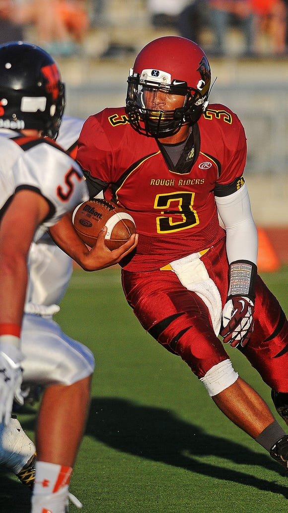 Roosevelt's Taryn Christion (3) rushes with the ball during a game against Washington on Friday, Sept. 5, 2014, at Howard Wood Field in Sioux Falls, S.D.
