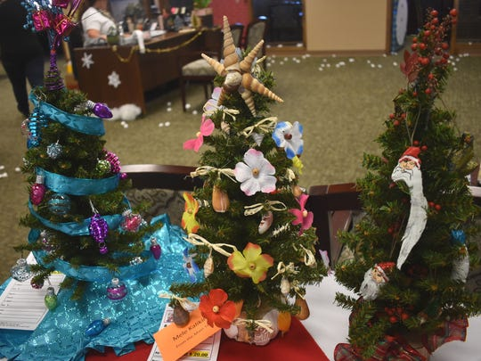 First National Bank auctioned off mini decorated Christmas trees as a way to fundraise for the causes they donate to during the year.