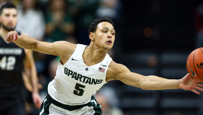 Michigan State guard Bryn Forbes (5) dives for loose ball during the first half of the win over Binghamton Saturday at the Breslin Center.
