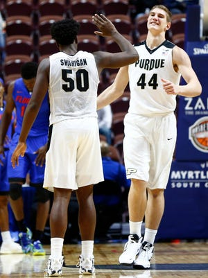 Purdue forward Caleb Swanigan (50) and center Isaac Haas (44) celebrate against the Florida Gators during the second half at Mohegan Sun Arena.