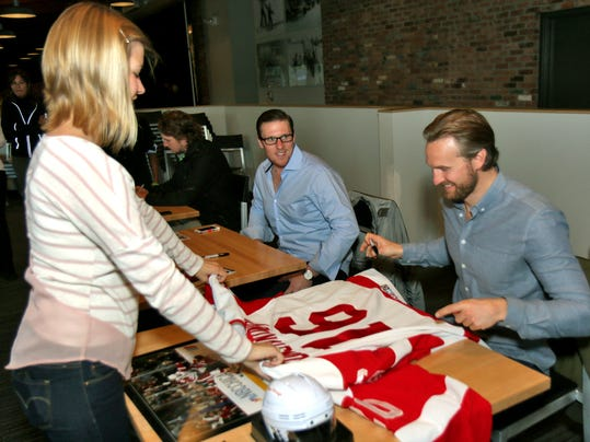 GT Jimmy Howard teases Niklas Kronwell as he signs an autograph for a young .jpg