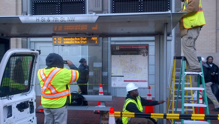 Crews install real-time informational displays at bus