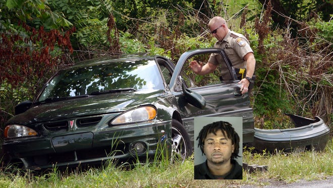 Sgt. J.L. Sholes of the Augusta County Sheriff's Office investigates the suspect's July 11. Insert photo: Suspect Jovon H. Keys, 23, in a 2012 photo from a previous arrest.