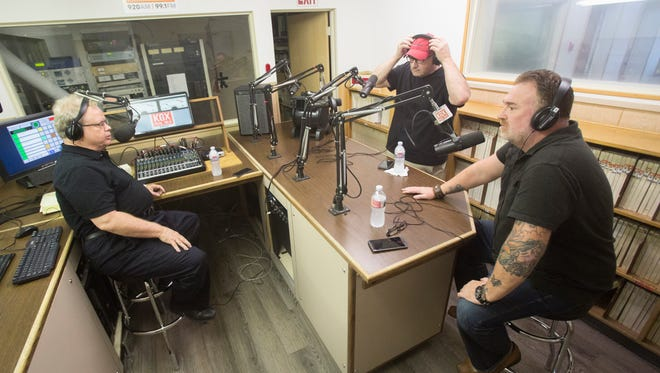 From left to right, radio host Kevin Barrett, radio producer Anthony Veneziano and radio personality Chad Benson were photographed at the KGX 920 AM radio station in Cathedral City on the day the station re-launched.