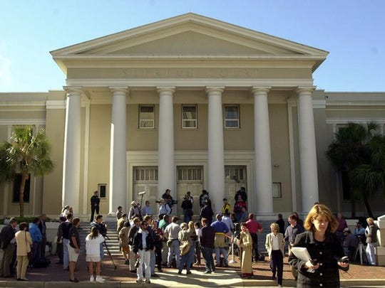 Reporters gather on the steps of the Florida Supreme Court Building in Tallahassee. (AP Photo/Dave Martin)