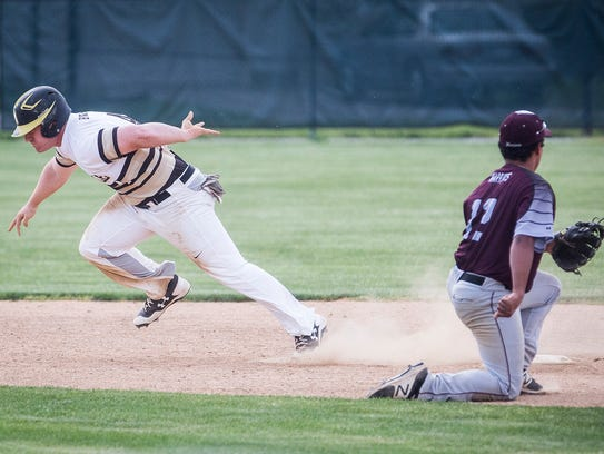 Daleville's Corbin Maddox steals third against Wes-Del
