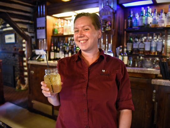 Bartender Kacy Steberg holds one of the restaurant's