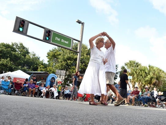 """Lois and George McAllan, of Vero Beach, dance May 27, 2016, to live music by """"The Jacks"""" during the Downtown Friday event presented by Main Street Vero Beach along 14th Avenue and 21st Street in downtown Vero Beach. SmartAsset ranked Vero Beach as the sixth best place to retire in Florida."""