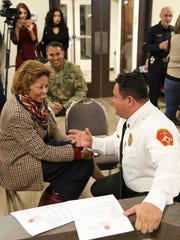 Sunland Park Fire Chief Andres Burciaga, right, meets with Sunland Park City Manager Julia Brown.