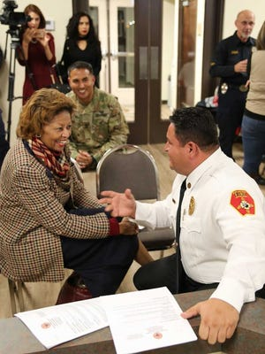 Sunland Park City Manager Julia Brown meets with Sunland Park Fire Chief Andres Burciaga on Tuesday, during a special city council meeting to announce Brown's hire.