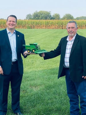 U.S. Rep. Andrew Chesney, R-Freeport, was recently named an Illinois Farm Bureau honoree for his 100% pro-agriculture voting record during his first full term in theIllinois House of Representatives. Pictured, from left: Andrew Chesney and Steve Fricke.