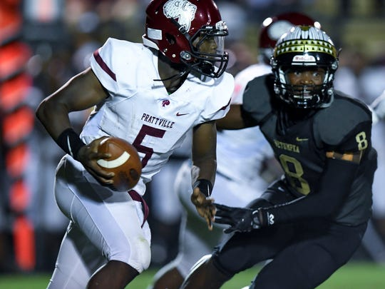 Prattville's Traair Edwards is chased by Wetumpka's Recardio Bozeman at Hohenberg Field in Wetumpka, Ala., on Friday August 25, 1017.