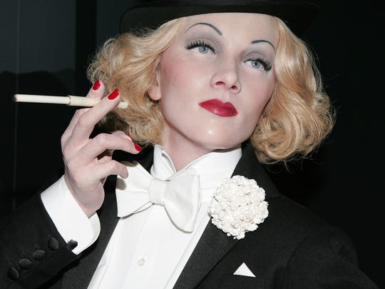 A wax figure of legendary actress Marlene Dietrich , who was known for performing in men's formal wear.