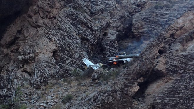 A Cessna 172 burns in the Virgin River Gorge after it crashed Sunday night.