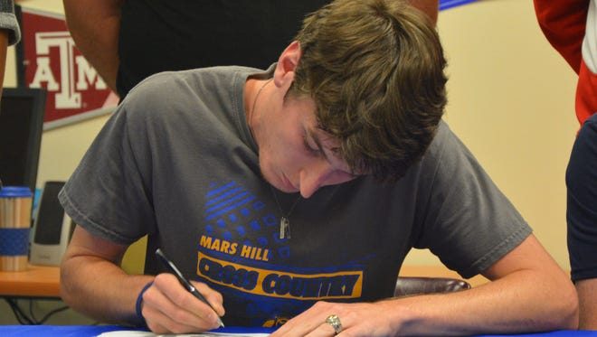 Madison senior Noah Allison has signed to run cross country and track for Mars Hill.