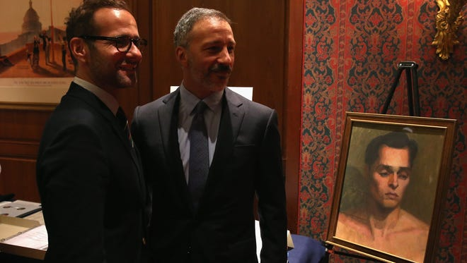 "David Kohan, right, and Max Mutchnick, creators of ""Will & Grace,"" at Smithsonian's National Museum of American History with a show prop donated to the collection. documenting history of LGBT Americans, on Aug. 19."