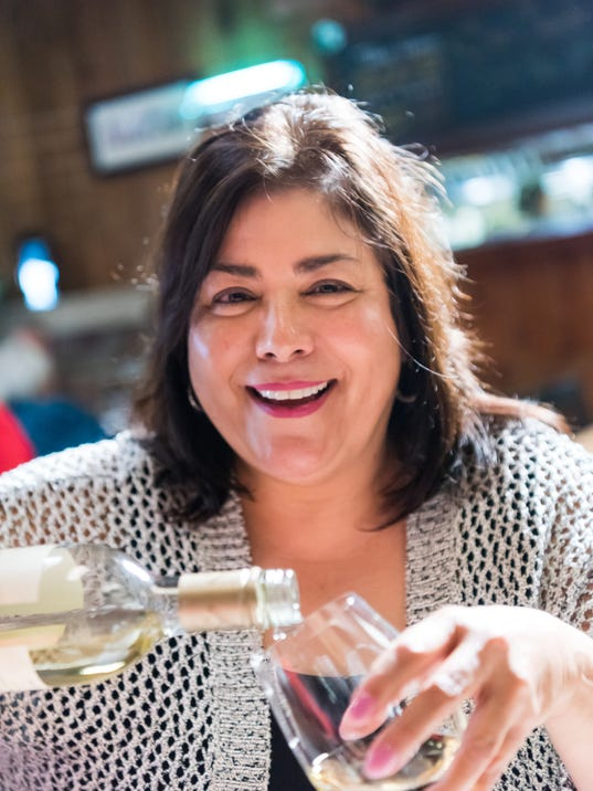 Mature woman having a glass of wine in a tavern