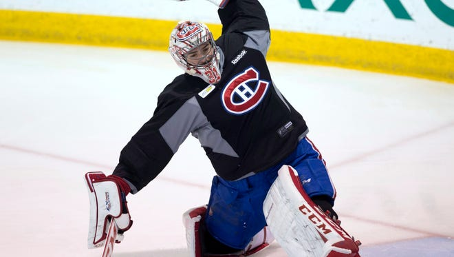 Montreal Canadiens goalie Carey Price makes a glove save during practice Friday in Brossard, Quebec.