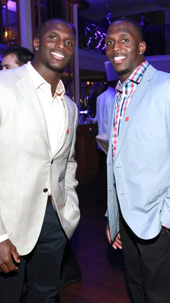 Titans cornerback Jason McCourty, left, and Patriots safety Devin McCourty together in 2013.