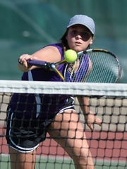 Hagerstown's Savannah Houck returns the ball while