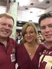 Steve Gabbard, left, with wife Kim and their son Stephen.