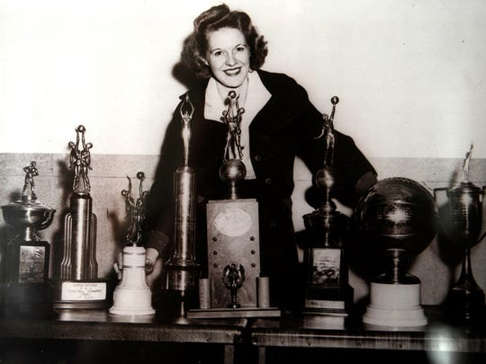 Alline Banks Sprouse poses with trophies in this undated photo courtesy the Banks family.