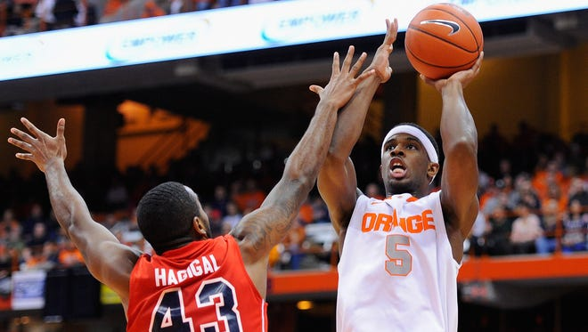 Nov 18, 2013; Syracuse, NY, USA; Syracuse Orange forward C.J. Fair (5) shoots the ball in front of St. Francis Terriers guard Sheldon Hagigal (43) during the first half at Carrier Dome. Mandatory Credit: Rich Barnes-USA TODAY Sports ORG XMIT: USATSI-144558 ORIG FILE ID:  20131118_ads_ai8_023.JPG