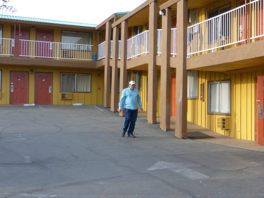 Vernon Price takes a walk Monday to the lobby at the Ponderosa Inn. Through the Bridges to Housing program, Price was able to move into the motel last October.