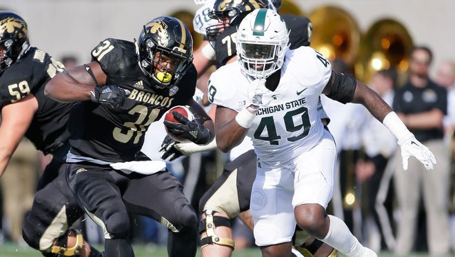 Western Michigan running back Jarvion Franklin is pursued by Michigan State linebacker Shane Jones during the first half Saturday, Sept. 9, 2017, in East Lansing.
