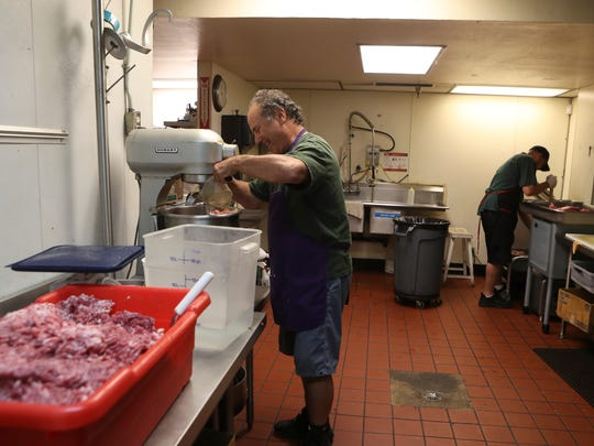 Furnari Sausage Company owner Joe Furnari, left, and prep cook Scott Marquis prepare to make sausage at the business in downtown Redding.